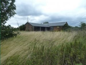 Barn set in rough grassland